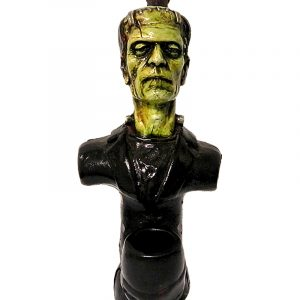 Handcrafted medium-sized tobacco smoking hand pipe of a classic green Frankenstein monster.