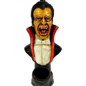 Handcrafted medium-sized tobacco smoking hand pipe of a classic Dracula vampire with bloody fangs.