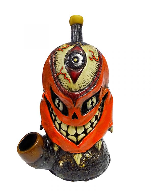 Handcrafted medium-sized tobacco smoking hand pipe of a red demon with a large third eye and a creepy smile.