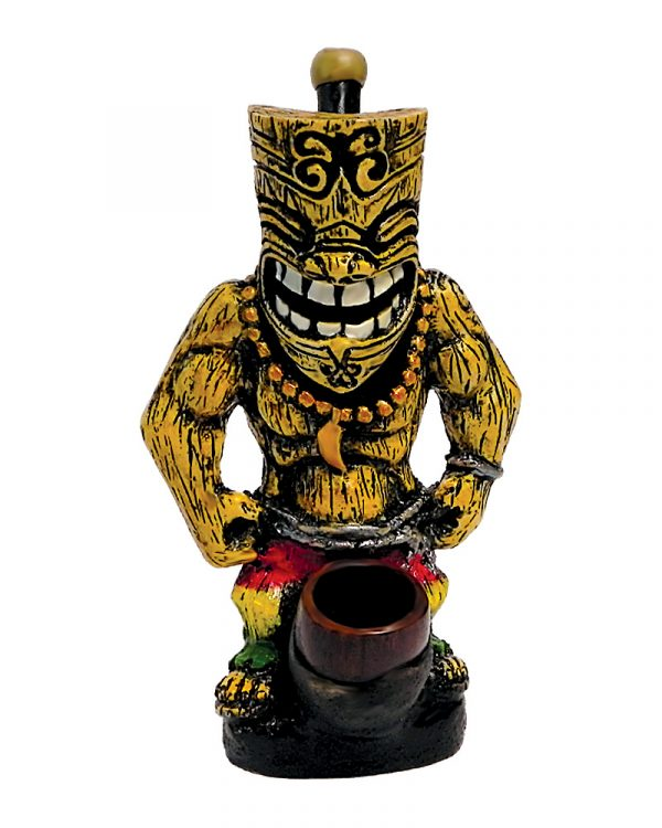 Handcrafted medium-sized tobacco smoking hand pipe of a grinning Tiki man with beach shorts in Rasta colors.