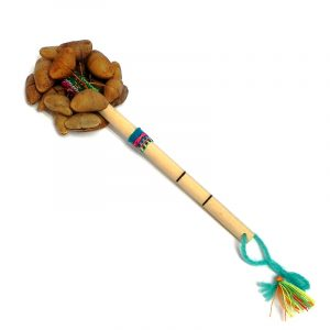 Handmade bamboo wooden stick rattle shaker music instrument with cacho seed pods and a cotton strap on handle.