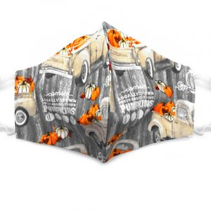 Handmade pumpkin pattern print fabric face mask with 100% cotton and elastic straps in gray, beige, orange and white adult size.
