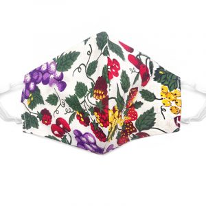 Handmade fruit medley print fabric face mask with 100% cotton and elastic straps in white and multicolored kid/teen size.