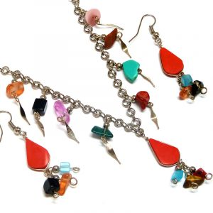 Handmade teardrop-cut stone cabochon necklace and matching earrings with multicolored chip stone and alpaca silver metal dangles in red howlite.