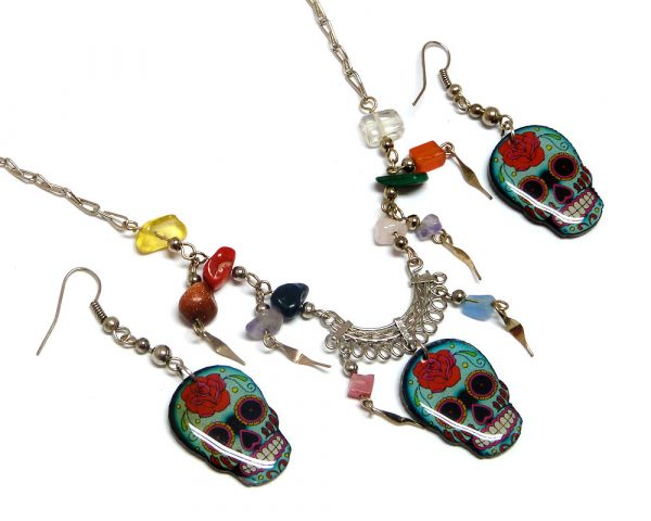 Day of the Dead floral rose sugar skull head acrylic necklace with multicolored chip stones and matching dangle earrings in mint, red, black, and white color combination.