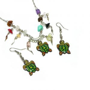 Handmade sea turtle acrylic necklace with multicolored chip stones and matching dangle earrings in green, lime green, yellow, and orange color combination.