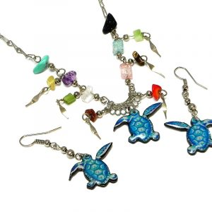 Handmade sea turtle acrylic necklace with multicolored chip stones and matching dangle earrings in turquoise, mint, and blue color combination.