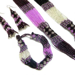 Handmade Czech glass seed bead multi strand necklace, matching bracelet, and beaded fringe dangle earrings with diamond pattern design in pink, burgundy, white silver, and black color combination.