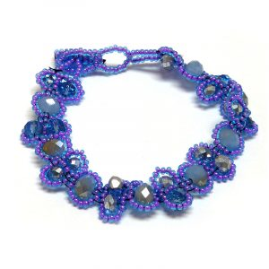 Handmade Czech glass seed bead and crystal bead oval link bracelet in purple lavender, periwinkle, light blue, and gray color combination.