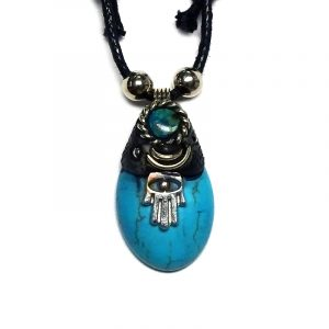 Handmade oval-shaped gemstone cabochon crystal pendant with resin, silver metal hamsa hand charm, and mini round chrysocolla stone on adjustable necklace in turquoise blue howlite.