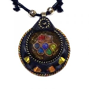 Round-shaped acrylic resin, copper metal wire, and crushed chip stone inlay orgonite pendant with 7 chakra rainbow circle pattern and black resin border on adjustable necklace.