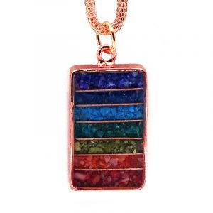 Handmade rectangle-shaped acrylic resin, copper wire, and crushed chip stone inlay orgonite pendant with 7 chakra rainbow striped pattern and copper metal setting on adjustable copper chain necklace.