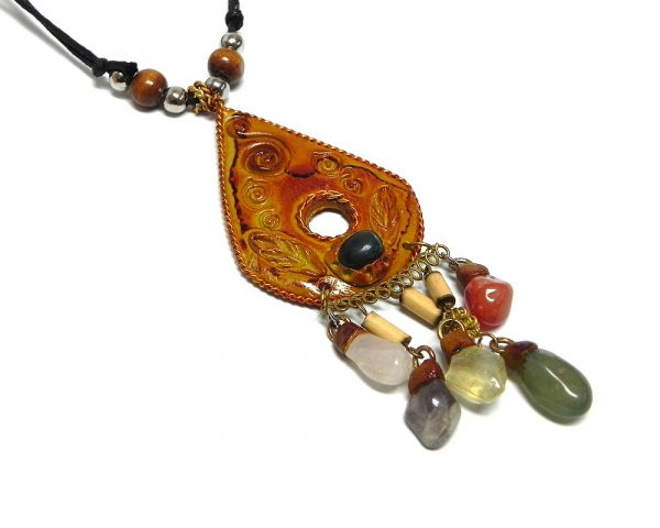 Teardrop-shaped leather pendant with multicolored tumbled gemstone dangles on adjustable necklace.