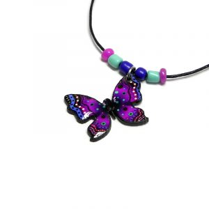 Handmade butterfly acrylic pendant with seed beads on black necklace in purple, turquoise mint, blue, black, white and hot pink color combination.