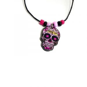 Handmade Day of the Dead sugar skull acrylic pendant with seed beads on black necklace in light pink, black, hot pink, and beige color combination.