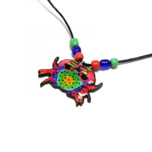 Handmade tropical crab acrylic pendant with seed beads on black necklace in red, blue, green, and yellow color combination.