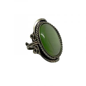 Handmade large oval-shaped cat's eye glass bead cabochon on adjustable alpaca silver metal ring with rope edge border in light green color.