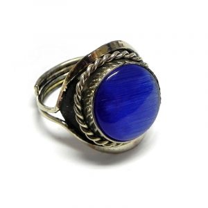 Handmade small round-shaped cat's eye glass bead cabochon on adjustable alpaca silver metal ring with rope edge border in blue color.