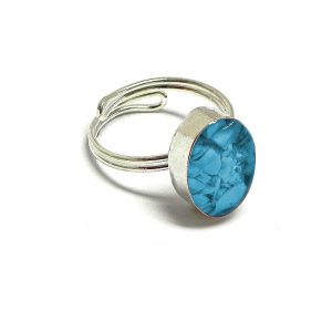 Handmade mini oval-shaped resin and crushed chip stone inlay cabochon on adjustable silver metal ring in turquoise blue color.