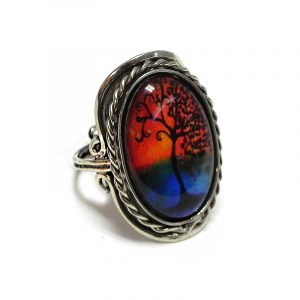 Handmade oval-shaped acrylic New Age themed sunset tree of life graphic design on alpaca silver metal ring with rope edge border in orange, blue, and black color combination.