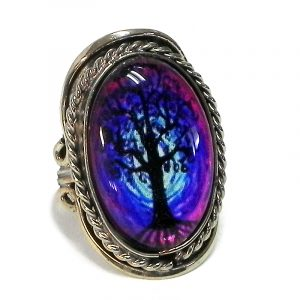 Handmade oval-shaped acrylic New Age themed tree of life graphic design on alpaca silver metal ring with rope edge border in purple, blue, light blue, and black color combination.