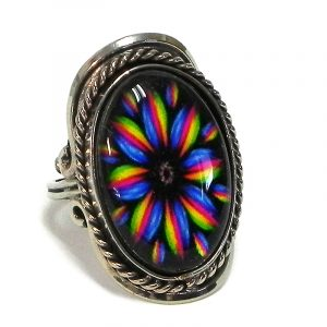 Handmade oval-shaped acrylic New Age themed floral mandala graphic design on alpaca silver metal ring with rope edge border in rainbow color combination.