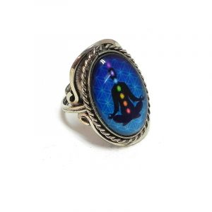 Handmade oval-shaped acrylic New Age themed flower of life chakra graphic design on alpaca silver metal ring with rope edge border in turquoise blue and rainbow multicolored color combination.