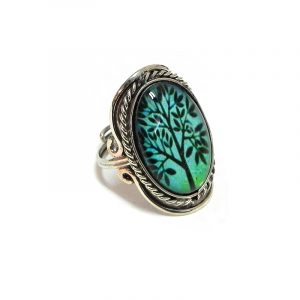 Handmade oval-shaped acrylic New Age themed tree of life graphic design on alpaca silver metal ring with rope edge border in mint green and black color combination.