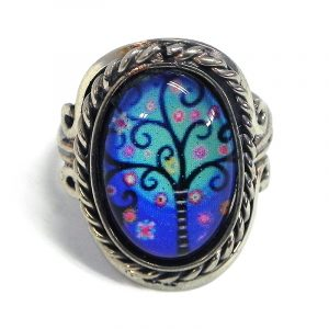 Handmade small oval-shaped acrylic New Age themed floral tree of life graphic design on alpaca silver metal ring with rope edge border in blue, turquoise, pink, and black color combination.