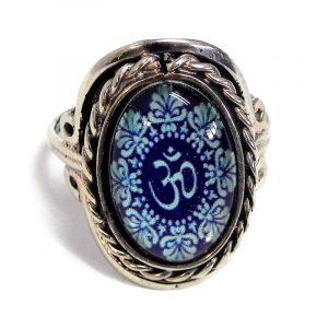 Handmade small oval-shaped acrylic New Age themed floral om sign graphic design on alpaca silver metal ring with rope edge border in dark navy blue and turquoise color combination.