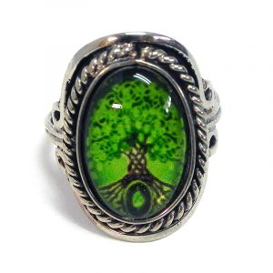 Handmade small oval-shaped acrylic New Age themed tree of life graphic design on alpaca silver metal ring with rope edge border in lime green and dark brown color combination.