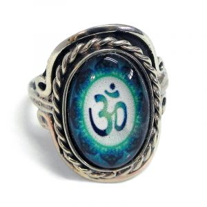 Handmade small oval-shaped acrylic New Age themed floral om sign graphic design on alpaca silver metal ring with rope edge border in teal green, green, and white color combination.