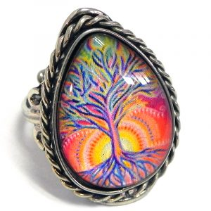 Handmade teardrop-shaped acrylic New Age themed sunrise tree of life graphic design on alpaca silver metal ring with rope edge border in peach, orange, golden yellow, hot pink, and blue color combination.