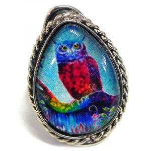 Handmade teardrop-shaped acrylic New Age themed owl graphic design on alpaca silver metal ring with rope edge border in tuquoise, blue, hot pink, and rainbow color combination.