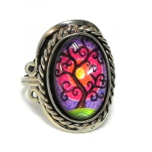 Handmade small oval-shaped acrylic New Age themed sunset tree of life graphic design on alpaca silver metal ring with rope edge border in hot pink, purple, lime green, orange, yellow, and dark brown color combination.