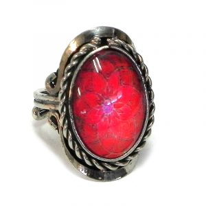 Handmade small oval-shaped acrylic New Age themed floral mandala graphic design on alpaca silver metal ring with rope edge border in red and hot pink color combination.
