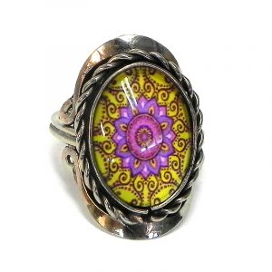 Handmade small oval-shaped acrylic New Age themed psychedelic floral mandala graphic design on alpaca silver metal ring with rope edge border in yellow, pink, magenta, and burgundy color combination.