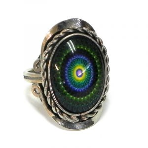 Handmade small oval-shaped acrylic New Age themed mandala graphic design on alpaca silver metal ring with rope edge border in dark green, indigo purple, yellow, and black color combination.