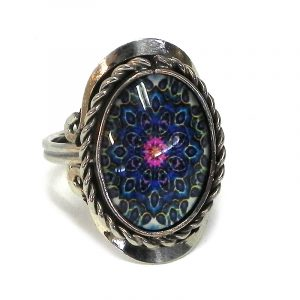Handmade small oval-shaped acrylic New Age themed psychedelic floral mandala graphic design on alpaca silver metal ring with rope edge border in dark blue, blue, pink, black, and white color combination.