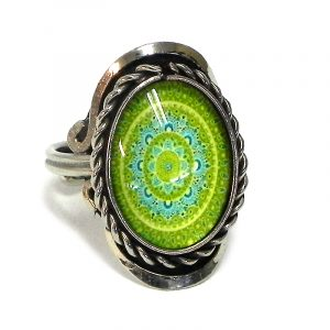 Handmade small oval-shaped acrylic New Age themed mandala graphic design on alpaca silver metal ring with rope edge border in lime green, turquoise miint, and teal color combination.