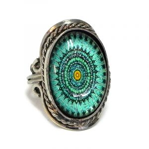 Handmade small oval-shaped acrylic New Age themed mandala graphic design on alpaca silver metal ring with rope edge border in turquoise mint, teal green, and golden yellow color combination.