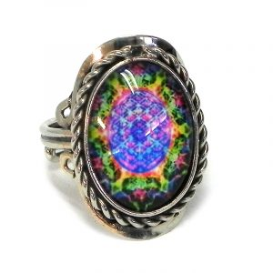 Handmade small oval-shaped acrylic New Age themed psychedelic mandala graphic design on alpaca silver metal ring with rope edge border in black and multicolored color combination.