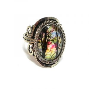 Handmade oval-shaped acrylic vintage themed watercolor tree graphic design on alpaca silver metal ring with rope edge border in multicolored and black color combination.