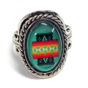 Handmade small oval-shaped acrylic Southwest themed pattern graphic design on alpaca silver metal ring with rope edge border in mint green, red, orange, yellow, and black color combination.