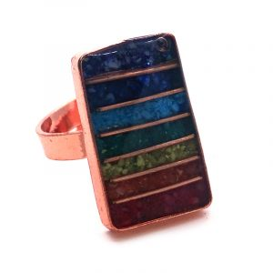 Rectangle-shaped acrylic resin, copper wire, and crushed chip stone inlay orgonite cabochon with 7 chakra rainbow striped pattern on adjustable copper metal ring.