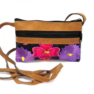Handmade small leather floral purse bag with tan vegan suede, embroidered cotton, zipper closure, outer pocket, and strap with blue fabric.