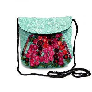 Handmade small floral purse bag with satin material, multicolored embroidered cotton, hook-and-loop-fastener and zipper closure, and strap in mint green.