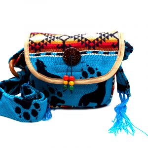 Handmade small southwest half moon purse bag with slight cushion, coco beads and button, hook-and-loop fastener and zipper closure, and adjustable strap in turquoise with wolf pattern.