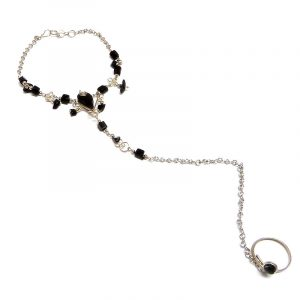 Handmade alpaca silver metal chain harem anklet with teardrop-cut stone and chip stone dangles, linked to mini round-shaped stone toe ring in black onyx.