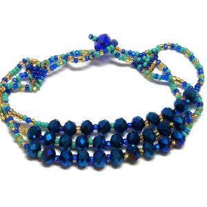 Handmade Czech glass seed bead multi strand bracelet with multiple crystal bead centerpiece in blue, turquoise mint, and gold color combination.